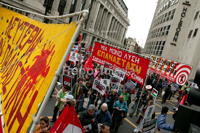 Greek trade union banners on an Anti war demonstration at the end of the European Social Forum held at Alexandra Palace. Central London. - Jess Hurd - 2004-10-17