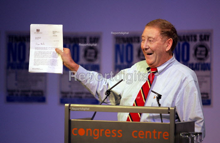 Austin Mitchell MP with a letter from John Prescott MP speaking at a Defend Council Housing National Conference. Congress House. London. - Jess Hurd - 2004-10-29