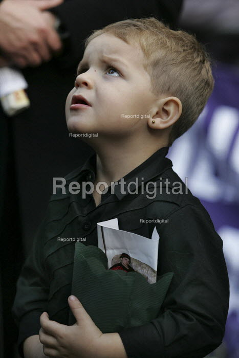 Tyler son of Benjamin Townsend clutches a photo of his father who died in prison. United Families and Friends Campaign march to Downing Street. London. - Jess Hurd - 2004-10-30