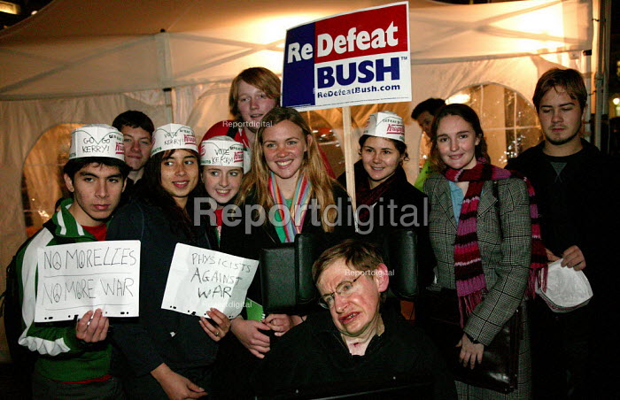 Professor Stephen Hawking posing with anti Bush physics students from Imperial College. Naming the Dead, Stop the War protest, Trafalgar Square, London 2004 - Jess Hurd - 2004-11-03