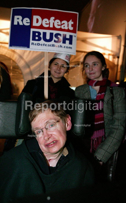 Professor Stephen Hawking with anti George bush Physics students from Imperial College. Naming the Dead, Stop the War protest, Trafalgar Square, London 2004 - Jess Hurd - 2004-11-03
