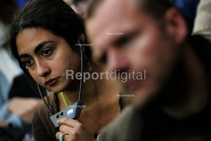 Delegate using audio translating equipment at the European Social Forum, Alexandra Palace. - Jess Hurd - 2004-10-15