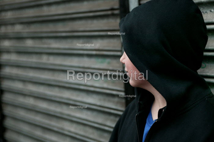 A boy from Lower Broughton. Youth feel they are being stoppd unfairly in the street by the police when they are wearing a hood. City of Salford. - Jess Hurd - 2004-11-08
