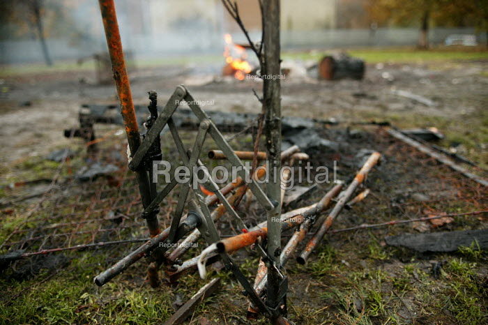 Remains of a pushchair in a smouldering urban fire on a housing estate in the City of Salford. - Jess Hurd - 2004-11-08