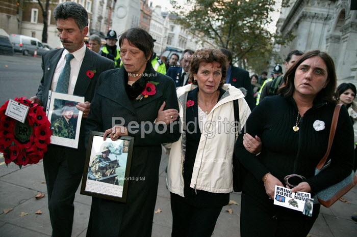Military Families Against the War take wreaths to lay at Number 10 Downing Street. Whitehall. London. - Jess Hurd - 2004-11-10