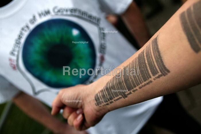 Protesters branded with bar codes. No2ID campaign against Identity Cards outside Parliament as the Queens Speech is delivered. London. - Jess Hurd - 2004-11-23