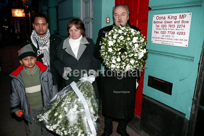 George Galloway Respect MP, Lindsey German StW, Olihur Rahman Respect councillor lay a wreath at Oona Kings surgery door in protest at her support for the Iraq war. Stop the War demonstration calling for an end to the occupation of Iraq, Tower Hamlets, East London. - Jess Hurd - 2004-11-27