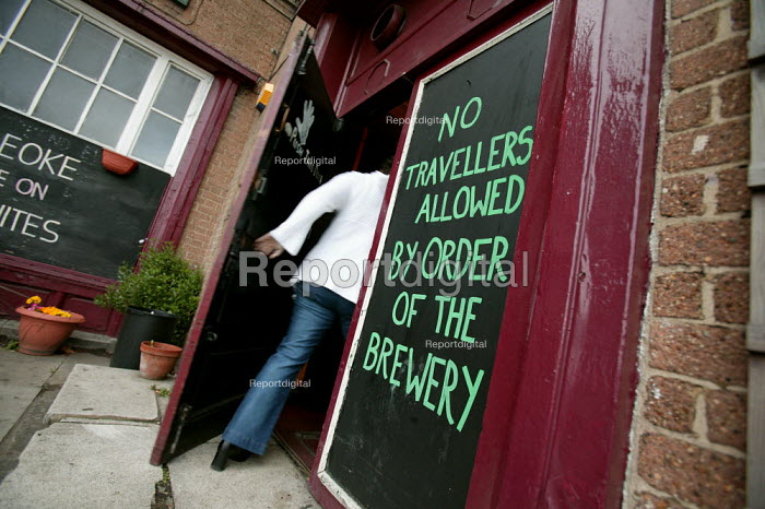 No Travellers Allowed sign outside an East London Pub. - Jess Hurd - 2005-01-01