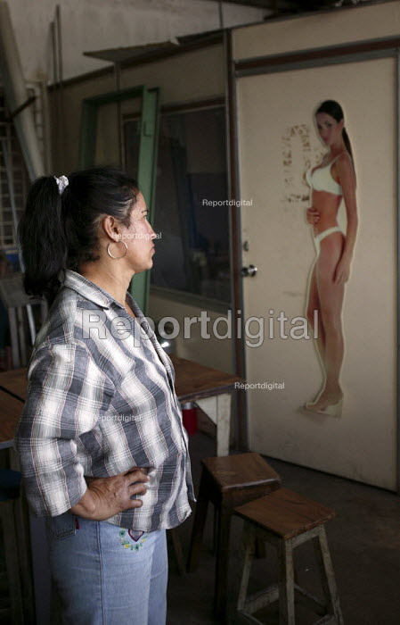 Venezuela Carmen Fuentes. Workers at Selfex Textile Factory occupy the building demanding co-management. The action by members of the Unete trade union is supported by the government of President Hugo Chavez. Caracas, Bolivarian Republic of Venezuela. - Jess Hurd - 2006-01-19