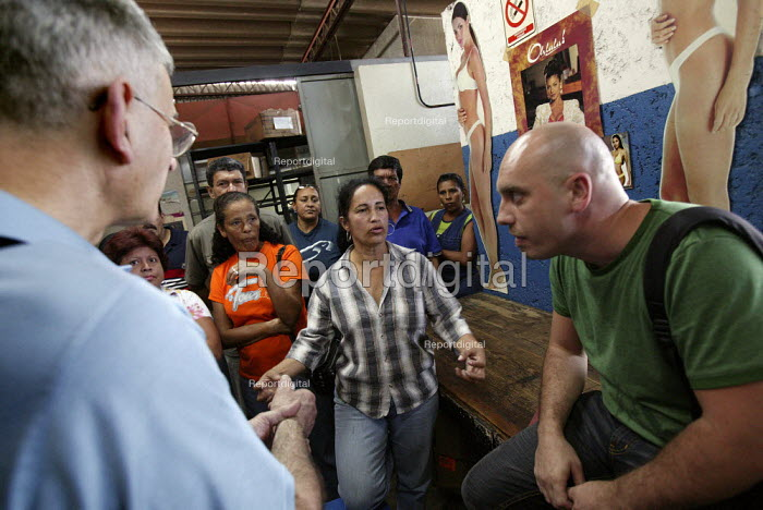 Carmen Fuentes being interviewed by journalists. Workers at Selfex Textile Factory occupy the building demanding co-management. The action by members of the Unete trade union is supported by the government of President Hugo Chavez. Caracas, Bolivarian Republic of Venezuela. - Jess Hurd - 2006-01-19