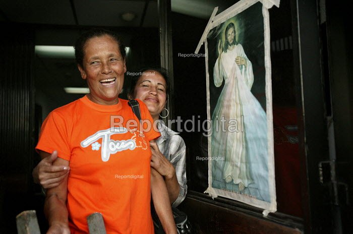 Workers put an image of Jesus Christ on the door at Selfex Textile Factory. They are occupying the building to demand co-management .The action by members of the Unete trade union is supported by the government of President Hugo Chavez. Caracas, Bolivarian Republic of Venezuela. - Jess Hurd - 2006-01-19
