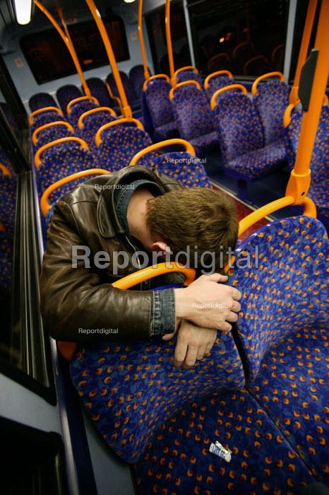 Man asleep on a London bus, New Years Day. - Jess Hurd - 2005-01-01