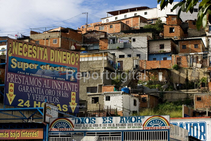 Advertisement for cash loans and pawnbrokers in a poor Barrio in Caracas, Bolivarian Republic of Venezuela. - Jess Hurd - 2006-01-26