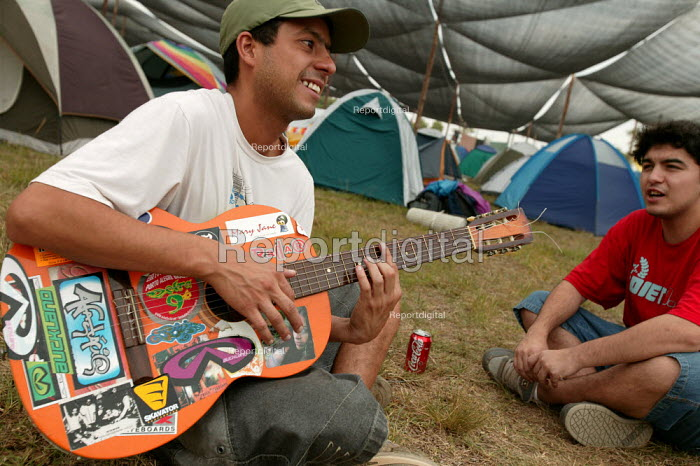World Social Forum, Porto Alegre Brazil. Delegate sing rebel songs with a guitar in the youth camp. - Jess Hurd - 2005-01-24