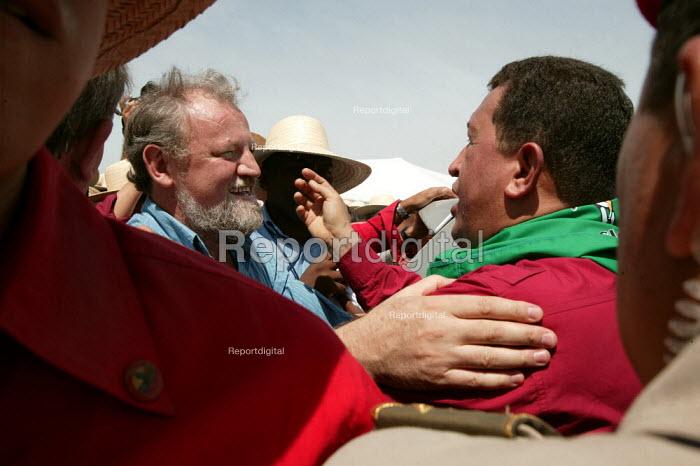 President Hugo Chavez of Venezuela (right) embrasses Joao Pedro Stedille MST leader on a visit to a Movimento dos Trabalhadores Rurais Sem Terra (MST, Landless Workers Movement) occupation in Tapes. World Social Forum, Porto Alegre Brazil. - Jess Hurd - 2005-01-30