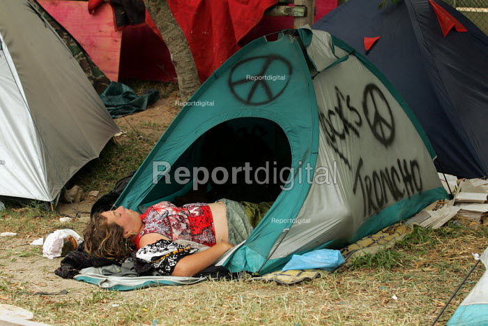World Social Forum, Porto Alegre Brazil. Delegate asleep in a tent daubed with anti war symbols in the youth camp. - Jess Hurd - 2005-01-24