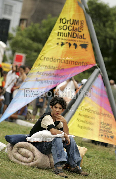 World Social Forum, Porto Alegre Brazil. Delegate waits to register for the forum. - Jess Hurd - 2005-01-25