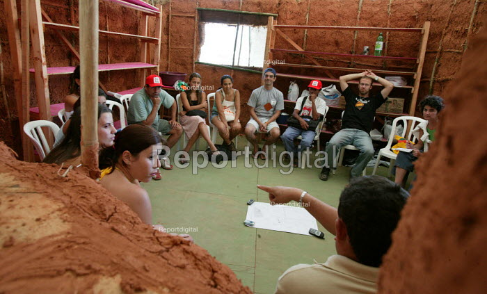 World Social Forum, Porto Alegre Brazil. Delegates in meet in a traditionally built mud hut at the youth camp. - Jess Hurd - 2005-01-25