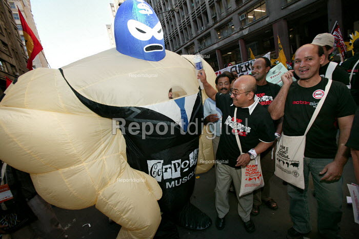 Actionaid Corporate Muscle gets a beating on the opening demonstration of the World Social Forum, Porto Alegre, Brazil - Jess Hurd - 2005-01-25