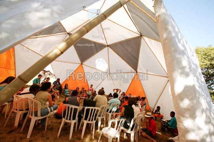 World Social Forum, Porto Alegre Brazil. Delegates meet in Bamboo constructed dome tents. - Jess Hurd - 2005-01-27