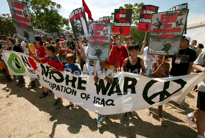 World Social Forum, Porto Alegre Brazil. Local youth join a Stop the War in Iraq demonstration through the forum. - Jess Hurd - 2005-01-28