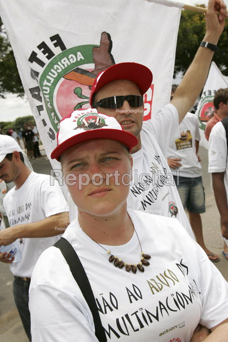 World Social Forum, Porto Alegre, Brazil. Small farmers, members of the Brazilian Dairy Union demonstrate outside a closed Parmalat milk factory. Campaign Against Corporate Abuse called by ActionAid Brazil and Federacao dos Trabalhadores na Agricultura Familiar FETRAF. - Jess Hurd - 2005-01-28