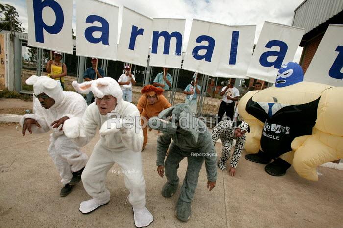 World Social Forum, Porto Alegre, Brazil. Small farmers, members of the Brazilian Dairy Union demonstrate outside a closed Parmalat milk factory. Animals represent characters from Parmalate advertising. Campaign Against Corporate Abuse called by ActionAid Brazil and Federacao dos Trabalhadores na Agricultura Familiar FETRAF. - Jess Hurd - 2005-01-28
