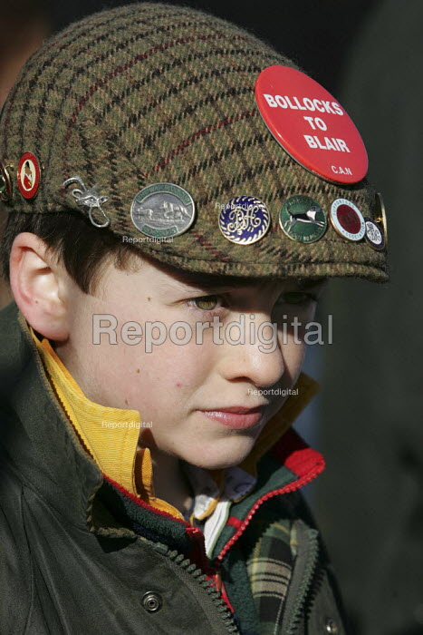Young fox hunting supporter says Bollocks to Blair as Belvoir, Cottesmore, Oakley Foot Beagles and Quorn hunts meet in Melton Mowbray for the first time after the ban on hunting with dogs came into force. Leicestershire. - Jess Hurd - 2005-02-19