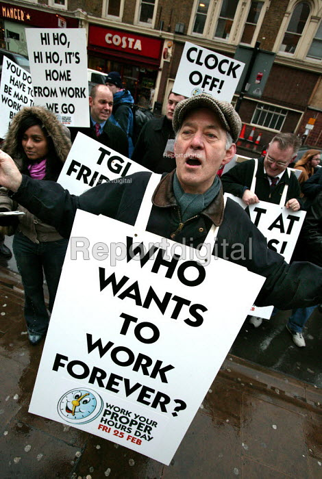 Commuters arriving at Liverpool Street station are greeted by a group of apparent protesters with light-hearted placards, sandwich boards and leaflets urging them to take a proper lunch and go home on time as its the TUCs Work Your Proper Hours Day. London. - Jess Hurd - 2005-02-25