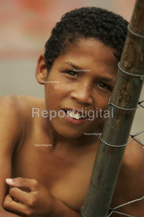 Young lad plays in Magdalena Favela, Sao Paulo where families live in slum housing, Brazil. - Jess Hurd - 2005-02-03