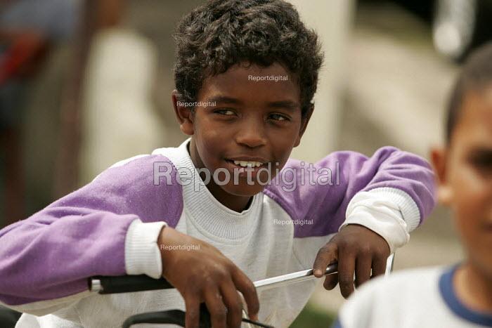 Teenager playing in Magdalena Favela, Sao Paulo where families live in slum housing, Brazil. - Jess Hurd - 2005-02-03