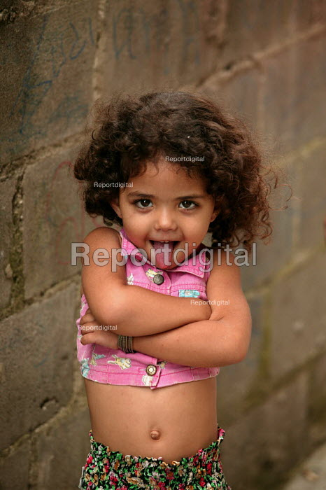 Young girl in Heliopolis Favela on the outskirts of Sao Paulo where families live in slum housing, Brazil - Jess Hurd - 2005-02-08