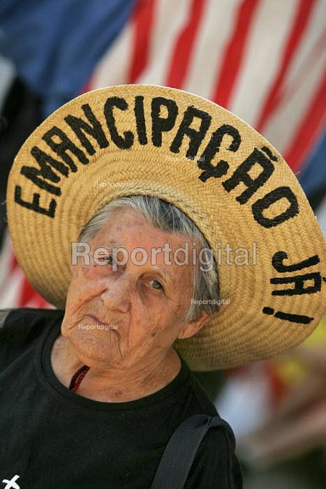 Brazilian land campaigner at the World Social Forum, Porto Alegre Brazil. - Jess Hurd - 2005-01-28