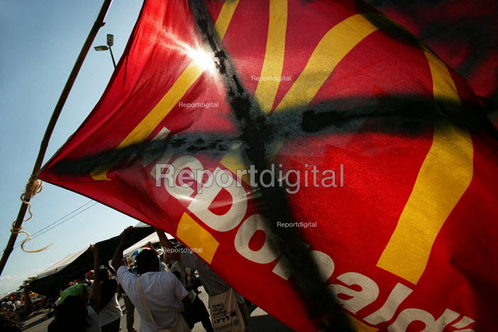 Anti McDonalds flag at the World Social Forum, Porto Alegre Brazil. - Jess Hurd - 2005-01-25
