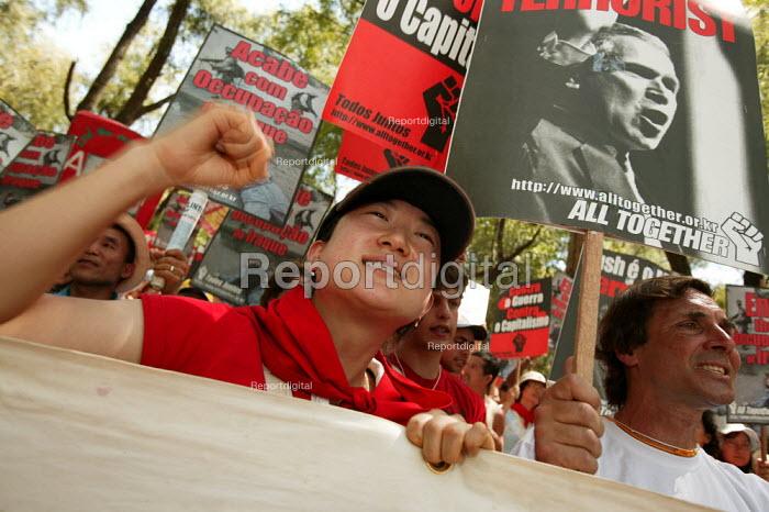 World Social Forum, Porto Alegre Brazil. Korean delegates join a Stop the War in Iraq demonstration through the forum. - Jess Hurd - 2005-01-28