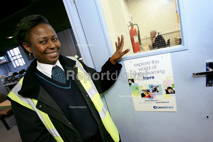 Bus driver using a computer in the Learning Facilities room at Tottenham Arriva Bus Garage. London. - Jess Hurd - 2005-03-09
