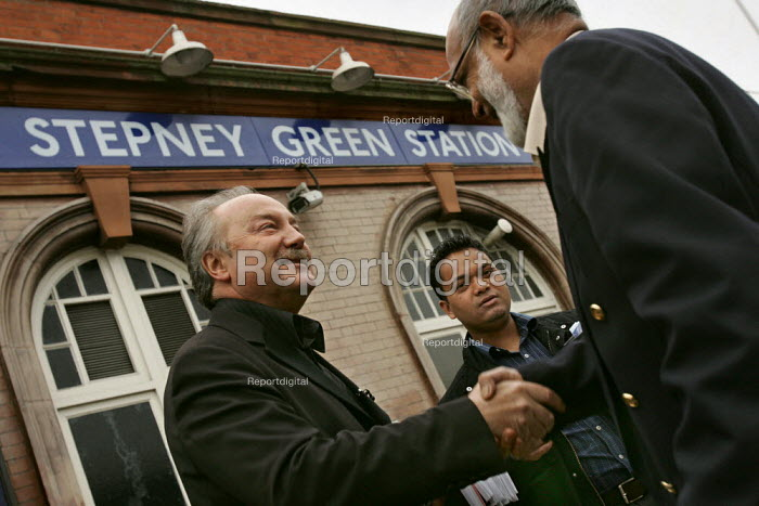 George Galloway Respect MP and Oliur Rahman Respect Councillor meet a supportive Bengali resident outside Stepney Green Station. East London. - Jess Hurd - 2005-03-30