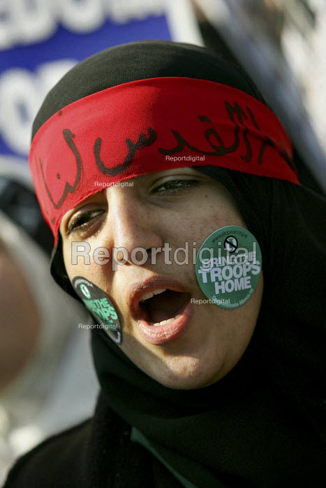 Muslim woman with a Freedom for Palestine headscarf in Arabic. Stop the War Coalition Bring the troops Home demonstration calling for an end to the occupation of Iraq. Supported by CND and MAB. London. - Jess Hurd - 2005-03-19