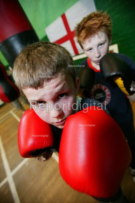 Daniel Hamilton (Front) and Michael Leach train at the St Georges Boxing Club. Poplar Boys and Girls Club. Tower Hamlets, East London. - Jess Hurd - 2005-03-22