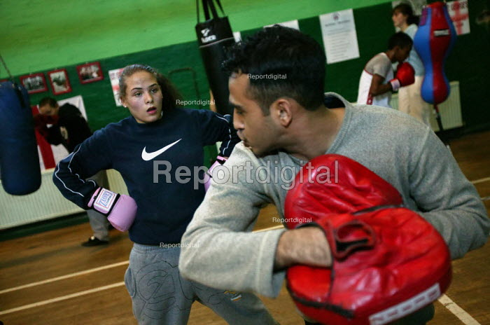 Sultan Mrah trainer and council employee at the St Georges Boxing Club. Poplar Boys and Girls Club. Tower Hamlets, East London. - Jess Hurd - 2005-03-22