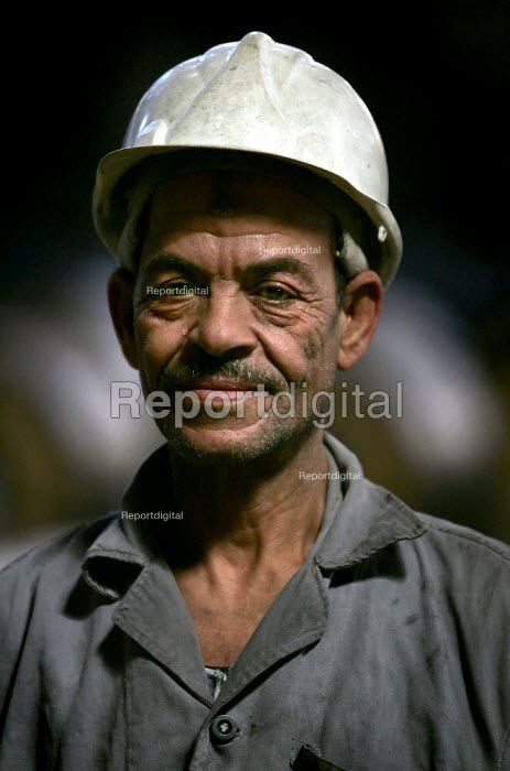 Portrait of a worker at the Egyptian Iron and Steel Company. Helwan, Cairo, Egypt. - Jess Hurd - 2005-03-13