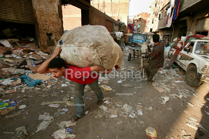 Mokattam, Cairo the Zabbaleen or garbage people, collect, sort and recycle rubbish. The government recently awarded contracts to private foreign companies to dispose of garbage, so jepodising the livelihoods of 60,000 Zabbaleen. Egypt. - Jess Hurd - 2005-03-26