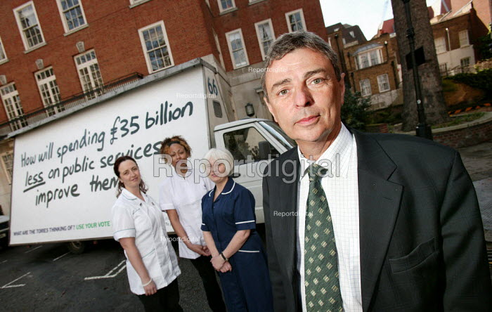 Dave Prentis Gen Sec Unison unveils a pastiche of the Conservative party's 'Are you thinking what we're thinking?' posters. London. How will spending �35 billion less on public services improve them? - Jess Hurd - 2005-04-18