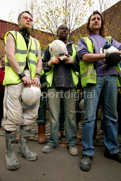 Construction workers walk of site at IPC media to observe one minute silence for International Workers Memorial Day. London. - Jess Hurd - 2005-04-28