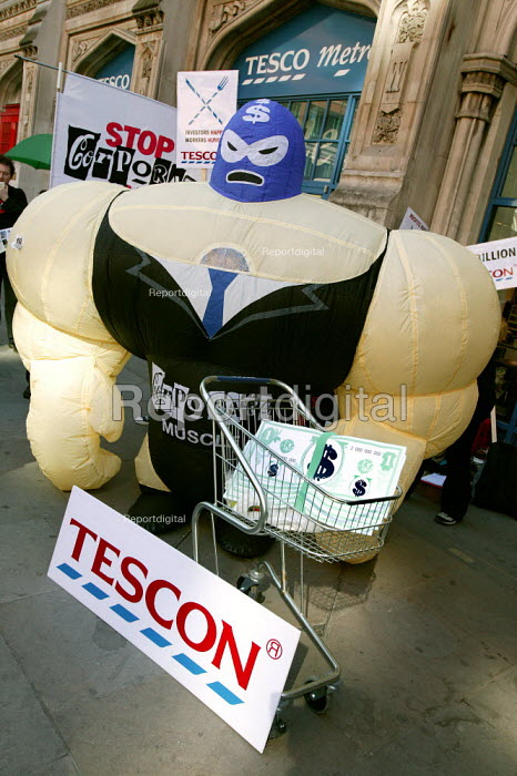 ActionAid Corporate Muscle outside Tesco Metro in Liverpool Street, London, on the eve of Tesco announcing record profits expected to exceed 2 billion pounds, ActionAid releases new research exposing the appalling working conditions of thousands of women workers in South Africa who produce fruit that ends up on Tesco shelves - Jess Hurd - 2005-04-11