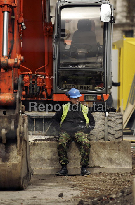 Road construction worker taking a rest sitting on his digger, Whitehall, London - Jess Hurd - 2005-04-13