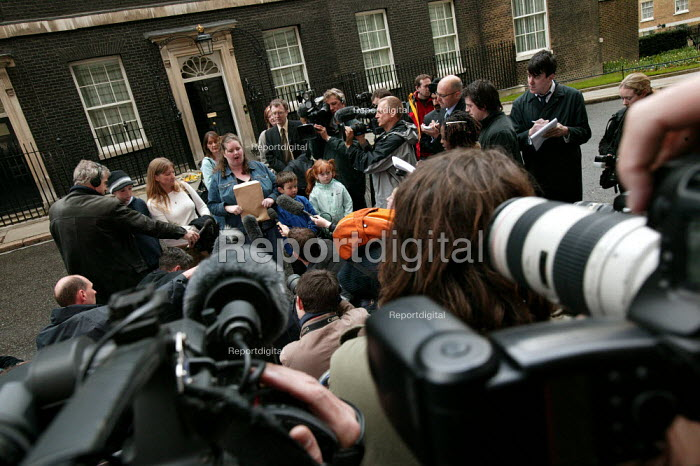 Gemma Cartwright gives an interview to the press as Longbridge women and their families at Downing Street protest against thousands of proposed job loses at MG Rover in Birmingham. - Jess Hurd - 2005-04-13