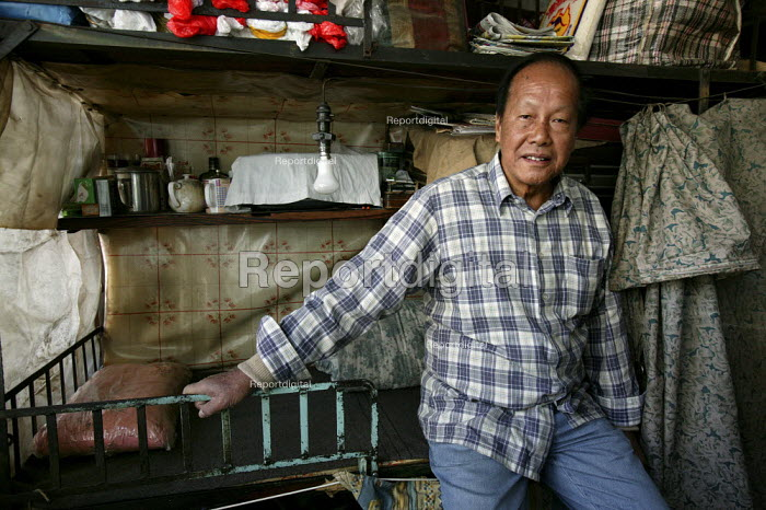 Wong Tung is one of the Hong Kong Caged People. He is a 64 year old single man and has lived in in cramped caged accommodation since he came to HK 30 years ago. He is now unemployed due to manufacturing jobs moving to the mainland. Hong Kong. - Jess Hurd - 2005-12-17