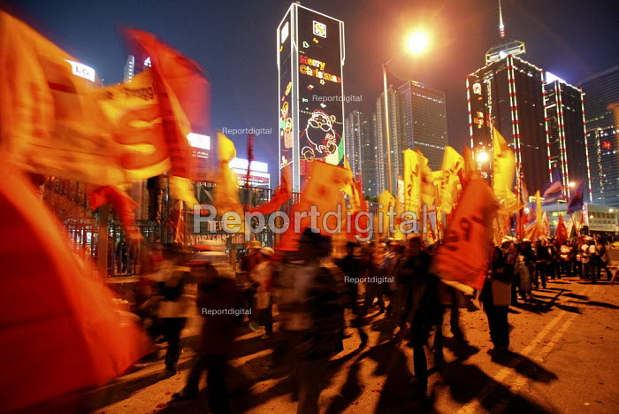 Migrant workers march on the closing day of the WTO Ministerial Meeting in Hong Kong. - Jess Hurd - 2005-12-18