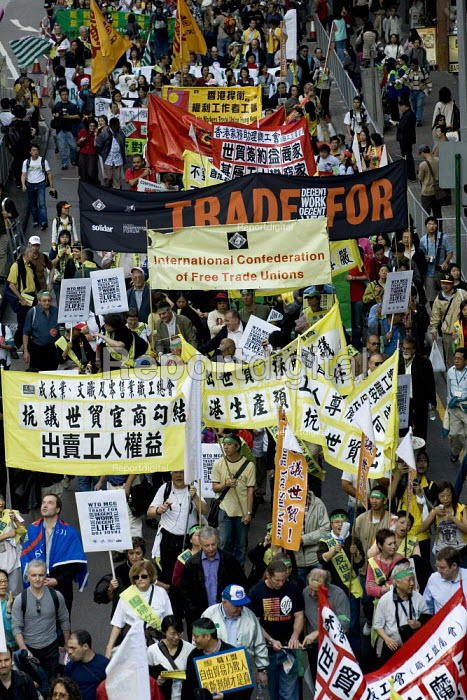 The Confederation of Free Trade Unions banner. Migrants assembly and rally on the eve of the WTO Ministerial Meeting in Hong Kong. - Jess Hurd - 2005-12-11